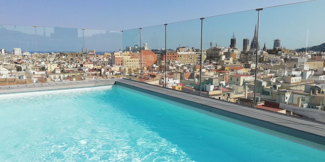 Starting the weekend! Reflection Water City Sky Blue Barcelona Catalunya Hotel Poolside Cityscape Infinity Pool Swimming Pool Discover  Luxury Wealth Luxury Hotel Raconets Pool Architecture Building Exterior Clear Sky Sunlight Building Day Night
