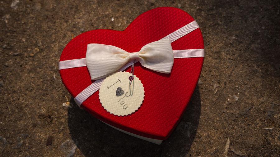 Close-up of heart shape box on floor