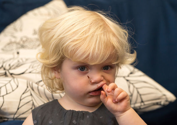 Blond girl with tooth ache. Ache Blond Child Chocolate Curly Dental Dentist Face Finger Food Girl Hand Mouth Nhs Teeth Toddler  Tooth Toothache Treatment Teething EyeEmNewHere