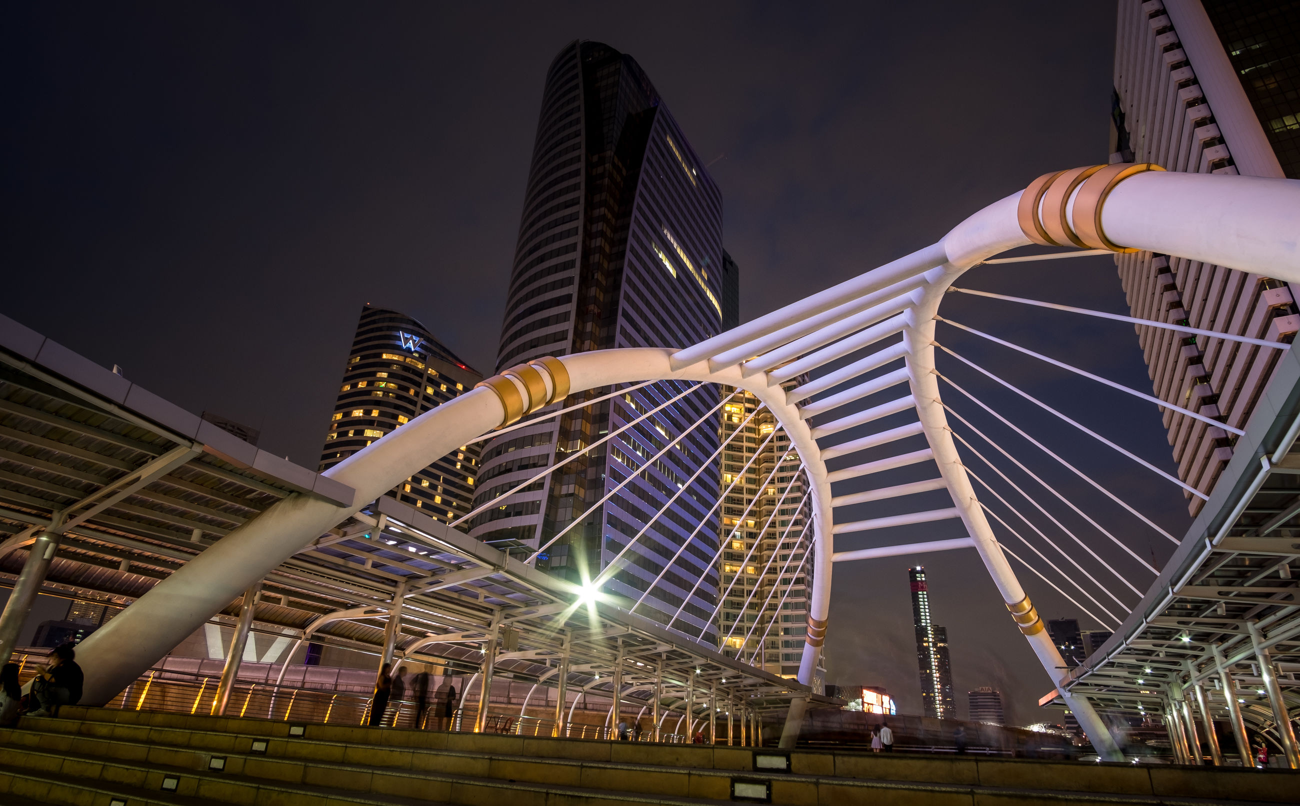 architecture, illuminated, building exterior, night, city, built structure, skyscraper, modern, low angle view, city life, sky, outdoors, people
