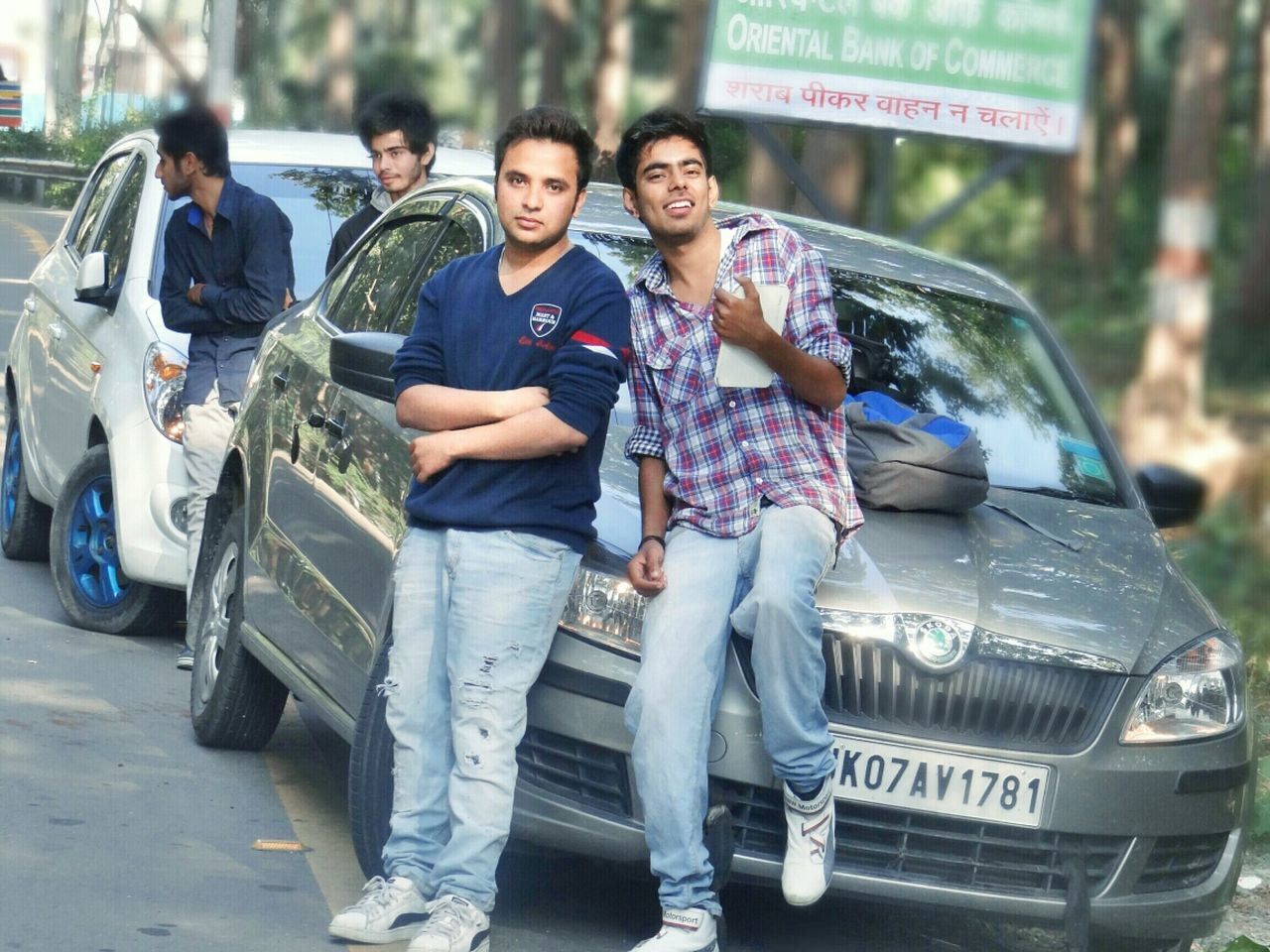 car, looking at camera, transportation, portrait, smiling, full length, front view, men, casual clothing, togetherness, young men, standing, outdoors, young adult, day, happiness, real people, people, adult, adults only