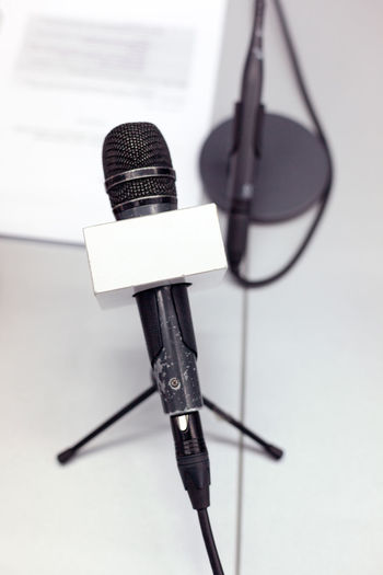 High Angle View Of Microphone Stand On Table