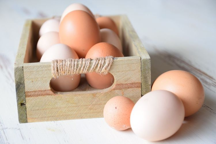 Close-up of eggs in container on table