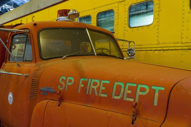 Fire engine, train museum Portola California Train Museum Museum Text Mode Of Transportation Western Script Transportation Land Vehicle Communication Car Safety Outdoors Motor Vehicle Capital Letter No People Yellow Occupation Day Close-up Accidents And Disasters Rescue Taxi Security
