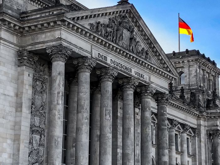 Bluesky and the Reichstag Architecture City Berlin Reichstag Blue Sky Architecture Architectural Column Built Structure Building Exterior Travel Destinations Flag History Government Tourism Low Angle View Travel Day Outdoors No People Sky City Politics And Government