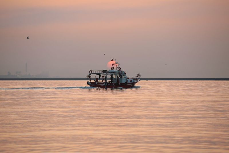 Fishingboat and sunset Water Transportation Sea Nautical Vessel Sky Sunset Mode Of Transportation Nature Beauty In Nature Architecture Outdoors Travel Men Ship Scenics - Nature Dusk Travel Destinations People