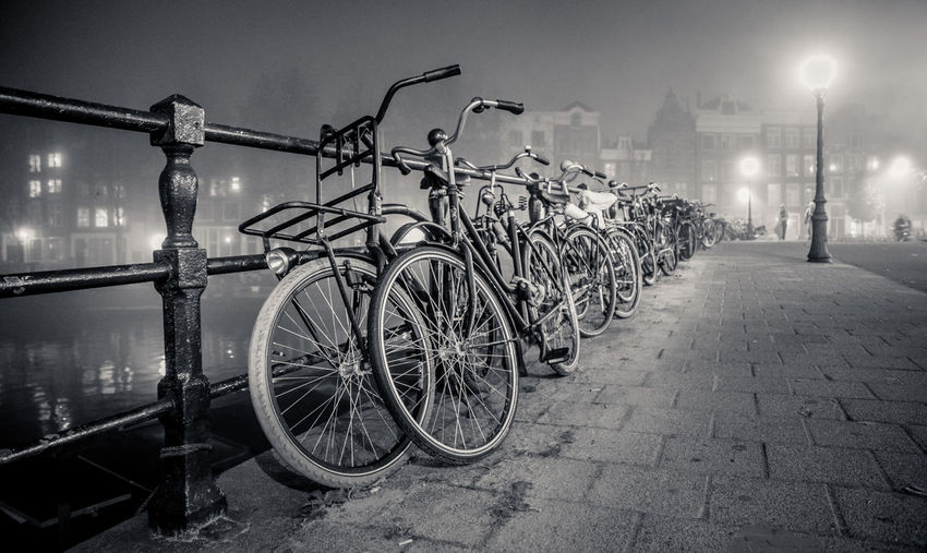 Architecture Bicycle Bicycle Rack Bike Black And White Blackandwhite Building Exterior Built Structure City Fahrrad Illuminated Land Vehicle Lighting Equipment Mode Of Transport Night Night Lights Nightphotography No People Outdoors Parking Sky Stationary Street Light Transportation Velo, Velocity Black And White Friday My Best Travel Photo