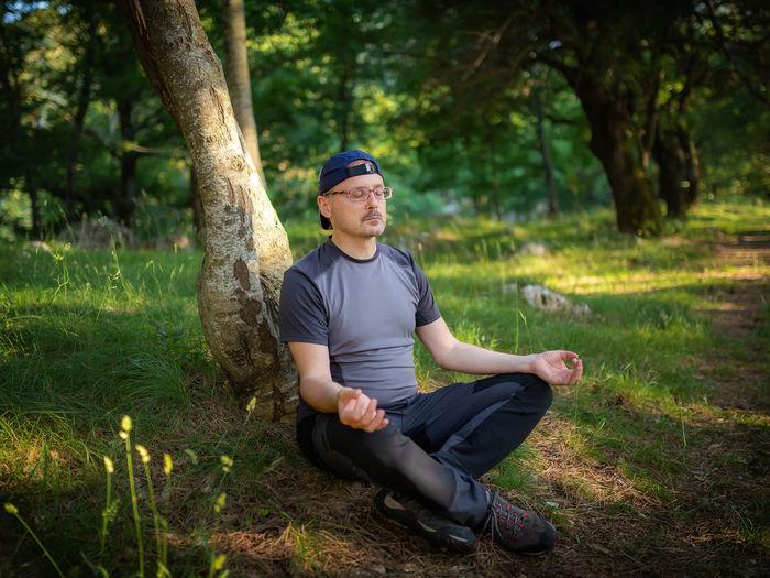 Full length of man sitting on grass