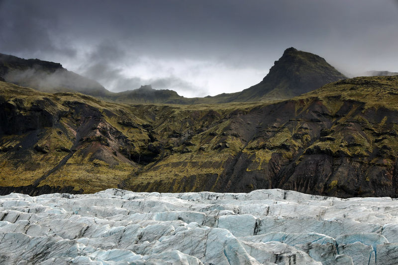 Scenic view of glacier on landscape against sky