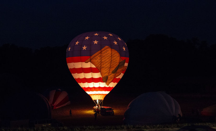 EyeEm Gallery Adventure Air Vehicle Balloon Ballooning Festival Celebration Copy Space Flying Glowing Hot Air Balloon Illuminated Incidental People Land Mode Of Transportation Nature Night Outdoors Sky Transportation