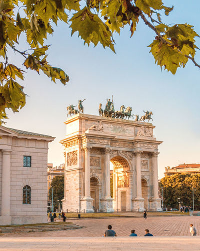 Italia Milan Milan,Italy Milano Peace Arch Tree Arch Architectural Column Architecture Building Exterior Built Structure Golden Hour Italy Leaves Monument Sky Sunset Tourism Travel Destinations Tree Triumphal Arch