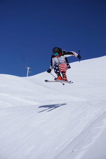 Skiing in Montgenevre Skiing Cold Temperature Day Full Length Holiday Leisure Activity Motion Mountain Nature One Person Outdoors Real People Ski-wear Skiing Skill  Sky Snow Sport Trip Vacations Warm Clothing White Color Winter Winter Sport