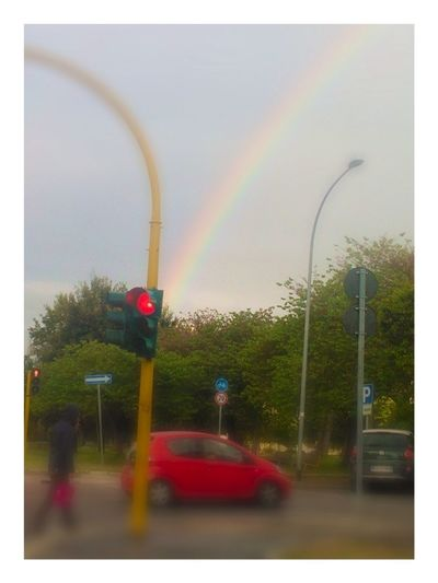 Waiting At The Traffic Light shoting the Rainbow , Looking Around me and realizing that everyone else is doing the same thing: Taking Photos of the rainbow :)