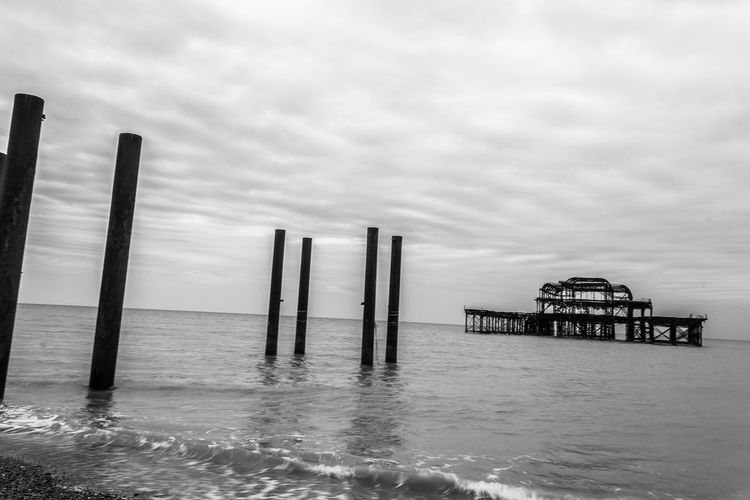 The Abandoned Pier - 2 Abandoned Abandoned Places Black And White Black And White Photography Brighton Calm Cloud - Sky Cloudy Jetty Outdoors Overcast Pier Pier Ruins Sea Sky The Great Outdoors - 2016 EyeEm Awards Tranquil Scene Tranquility Travel Travel Photography Water Weather Feel The Journey Visual Creativity British Culture