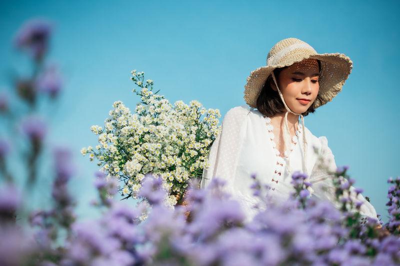 A woman standing in a flower field