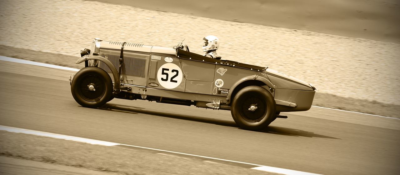 Auto Racing Car Day Land Vehicle Motion One Person Outdoors People Racecar Real People Speed Sports Race Transportation