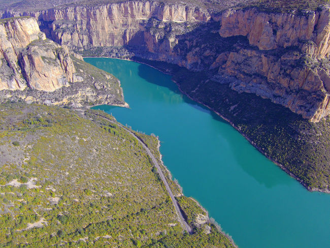 Drone  Nogera Pallaresa River Gorge In The Region Of La Noguera Province Of Lérida Train Of The Lakes Route From Lérida To The Seu Of Urgell Beauty In Nature Day Drone Photography High Angle View Mountain Nature Nautical Vessel No People Outdoors Physical Geography Scenics Sky Tranquility Water Waterfront