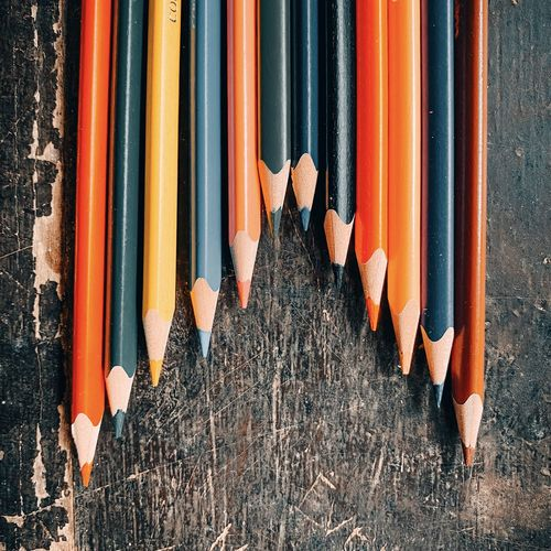 Directly above shot of multi colored pencils in row