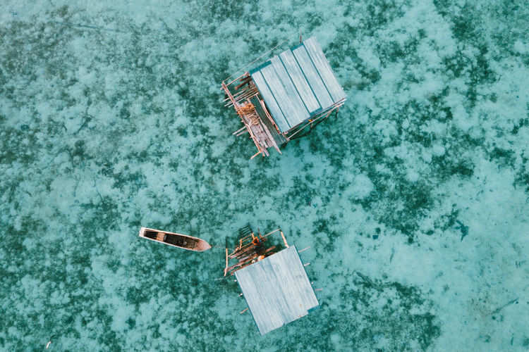 High angle view of abandoned swimming pool against sea