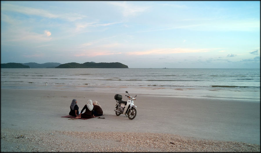Beach Calm Coastline Escapism Getting Away From It All Horizon Over Water Moped Muslim Ocean Outdoors Recreational Pursuit Rippled Sand Sea Seascape Shore Summer Togetherness Tranquil Scene Vacations Water Weekend Activities