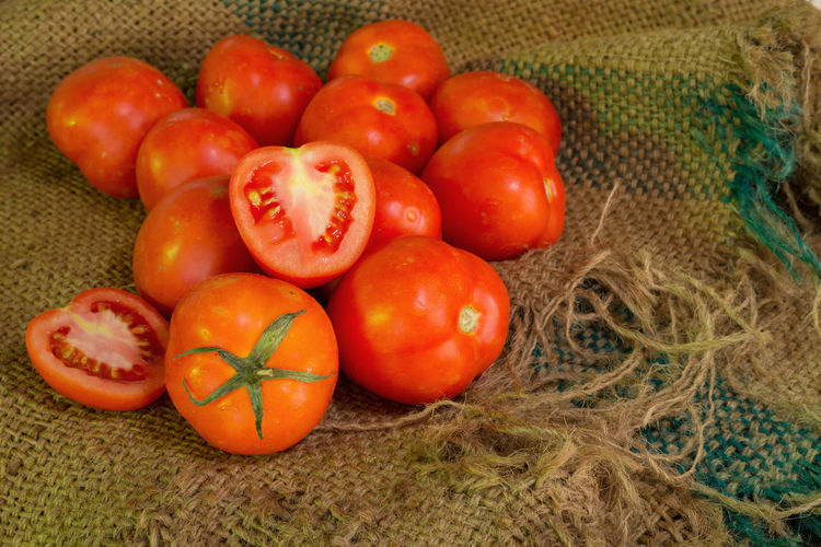 Close-up of tomatoes on sack