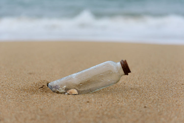 Some shells in a bottle on the beach, shore,cast out by ocean or sea Cork Hope Ocean View Travel Beach Beachphotography Bottle Close-up Communication Glass Horizon Leisure Nature No People Ocean Outdoors Sand Sea Shell Shore Summer Tropical Vacation Water