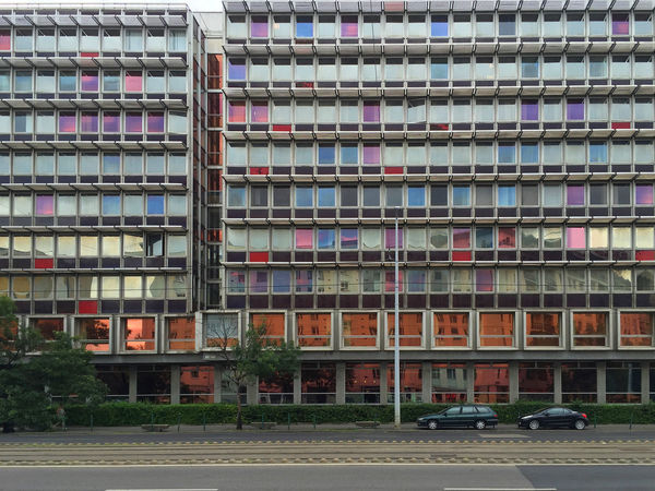 Building front with tinted windows Apartment Architecture Building Exterior Building Story Car City City Life Colorful Day Façade Glass Magenta Modern Office Building Parking Pattern Pink Purple Random Residential Building Road Street Tall - High Tint Transportation