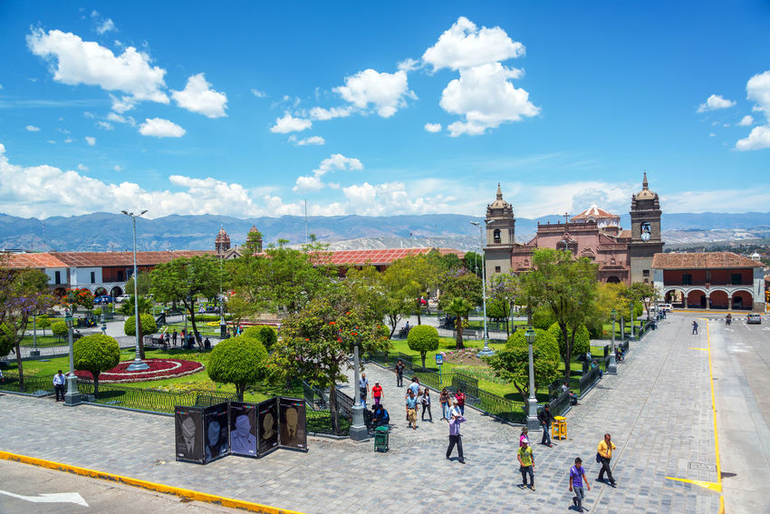 AYACUCHO, PERU - NOVEMBER 4: People passing through the Plaza de Armas in Ayacucho, Peru on November 4, 2014 Altitude Andes Architecture Ayacucho Perú Built Structure Cathedral Church Culture Historic History Inca Know Outdoors Person Peru Peruvian Plaza De Armas Sky South America Sucre Tourism Town Tree Vacations View
