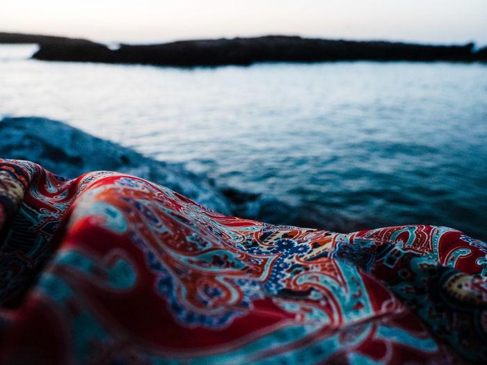 Colorful cloth at the sea