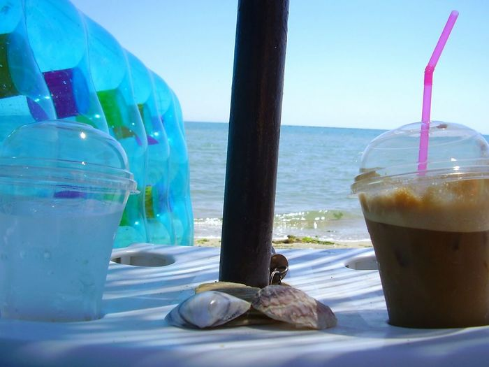 Liquid Lunch On The Beach Makrigialos Icedcoffee Frappe Water Eye4photography  Straw Greece Air Mattress Summer Memories 🌄 Summer Feeling Drinks Calmness Relax Blue Wave