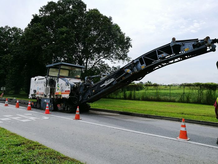 Milling and Patching in progress. Outdoors Road Construction Wirtgen Road Singapore Milling Patchwork Fields Tree Sky No People Day