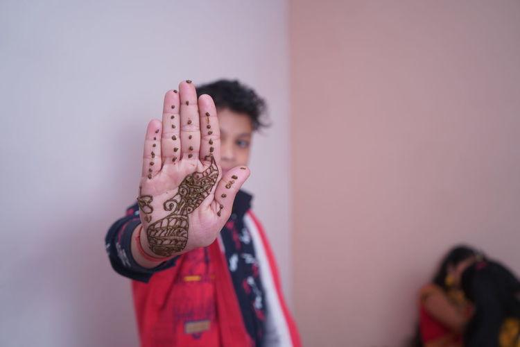 Boy showing henna tattoo