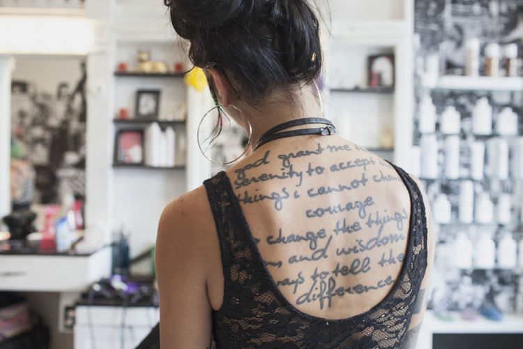 Rear view of woman with text