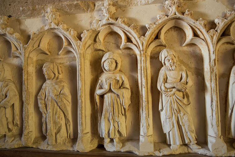 Angel Architecture Art And Craft Bas Relief Belief Built Structure Carving Craft Creativity History Human Representation Male Likeness No People Ornate Place Of Worship Religion Representation Sculpture Spirituality Statue The Past