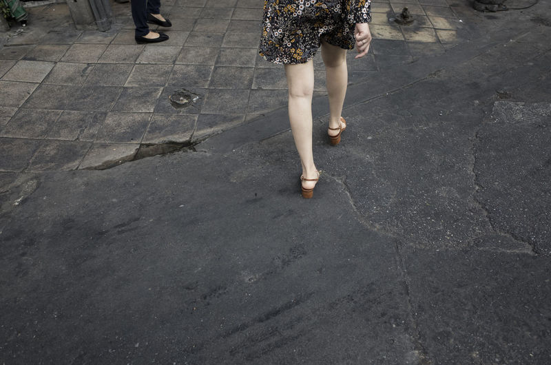 Low Section Body Part Human Body Part Walking Human Leg Women Lifestyles Real People Adult City Street Day High Angle View People Standing Group Of People Shoe Leisure Activity Footpath Outdoors Human Foot Human Limb