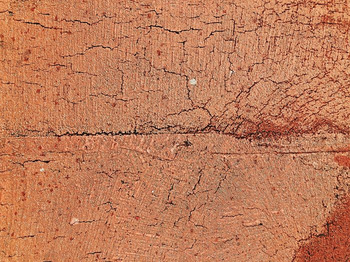 Cracked red colored road background texture Copy Space Lines Weathered Cracks Cracked Background Background Texture Road Street Full Frame Backgrounds Pattern Textured  No People Close-up Brown Outdoors Weathered Abstract Old Architecture Design Orange Color Nature
