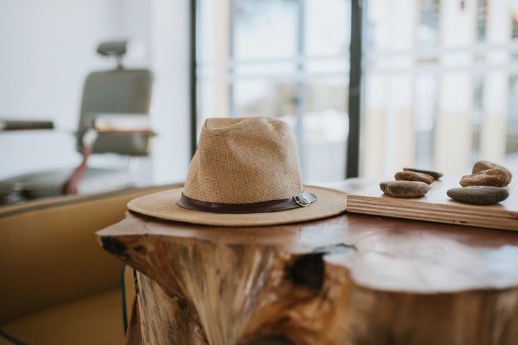 Hat Still Life Hats Wood - Material Table Indoors  No People Focus On Foreground Close-up Brown Day Selective Focus Personal Accessory Home Interior Chair Absence Window Music Seat Lifestyles Fashion Class