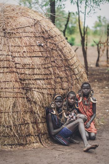 Africa Mursi Village Mursi African Portraiture Ethiopia Portrait Photography Portraits Ethiopian Photography 🇪🇹 Travel Travel Destinations Omo Valley Omovalley Portrait Of A Woman African Village Day Weapon Outdoors Nature Real People Gun Military Brown Lifestyles Women Land Plant Human Representation Sunlight Government