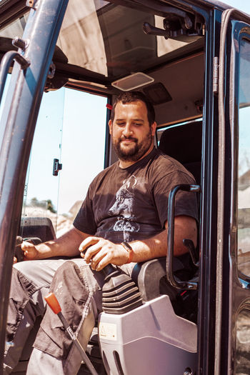 Portrait of man working at bus