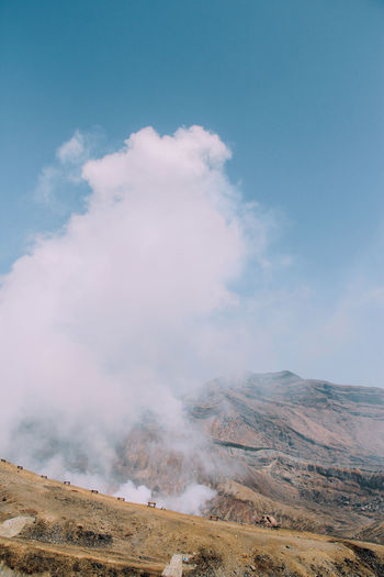 Smoke emitting from volcanic landscape