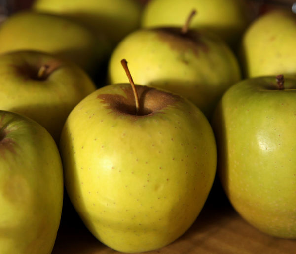 Close-Up Of Granny Smith Apples For Sale At Market
