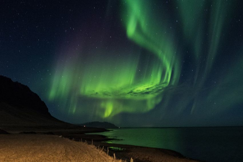 Northern Lights over the Ocean Iceland Nature Northern Lights Travel Aurora Polaris Dramatic Sky Green Color Landscape Outdoors Travel Destinations Go Higher