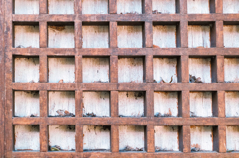 Vintage background with square wooden cells.