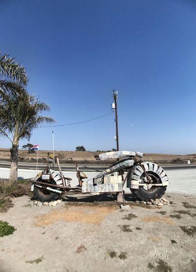 Abandoned vehicle on beach against clear sky