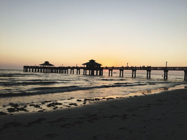 Fort Myers Beach Pier Sunshine State Florida Fort Myers Beach Pier Beach Sea Sunset Sand Beauty In Nature Nature Water Tranquil Scene