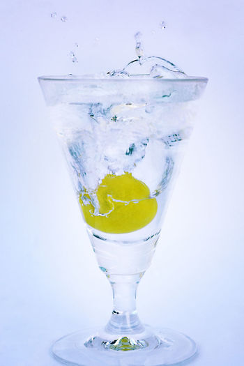 SPLASH Paint The Town Yellow Drinking Glass Drink Cocktail Studio Shot No People Refreshment White Background Fruit Freshness Water Close-up Day Tantebellecose Photographyislifee Tagsforlikes Photographer The Week On EyeEm EyeEmNewHere Photography Colorful Still Life StillLifePhotography Still Water Followme