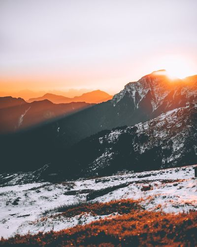 Sunset Mountain Nature Beauty In Nature Snow Scenics Tranquility Winter Cold Temperature Tranquil Scene Mountain Range Orange Color Outdoors Landscape Sunlight Sun No People Sky Day