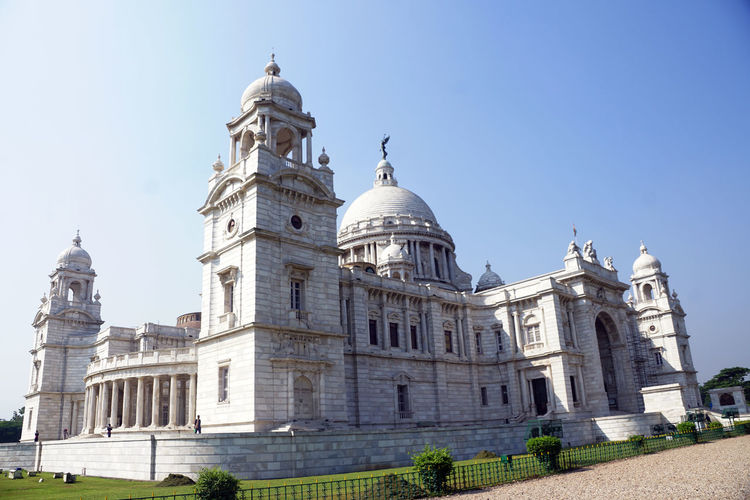Building Exterior Architecture Built Structure Dome Sky Religion Travel Destinations Nature Belief Low Angle View Spirituality History Place Of Worship No People Clear Sky The Past Day Building Travel Outdoors Government Architectural Column Victoria Memorial Kolkata