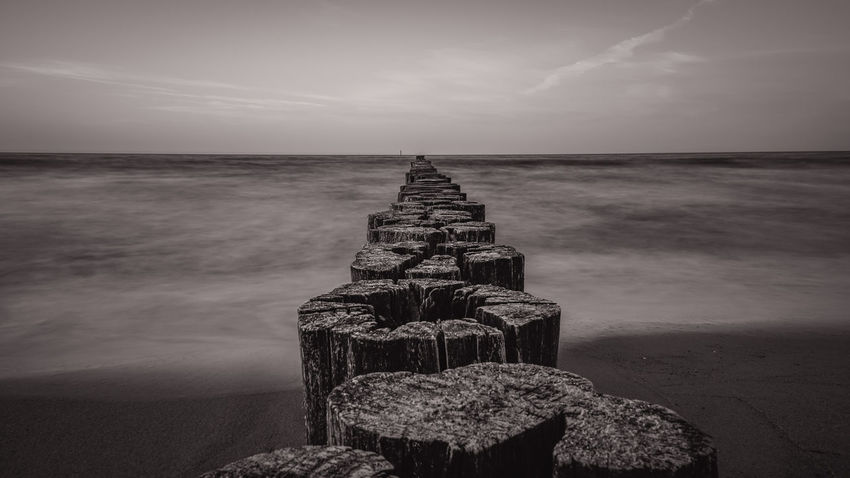 Epic Sky on the Beach Sky And Clouds Beach Beachphotography Beauty In Nature Cloud - Sky Day Groyne Horizon Horizon Over Water Land Nature No People Outdoors Rock Rock - Object Scenics - Nature Sea Sky Solid Tranquil Scene Tranquility Water Waterfront Wood - Material Wooden Post