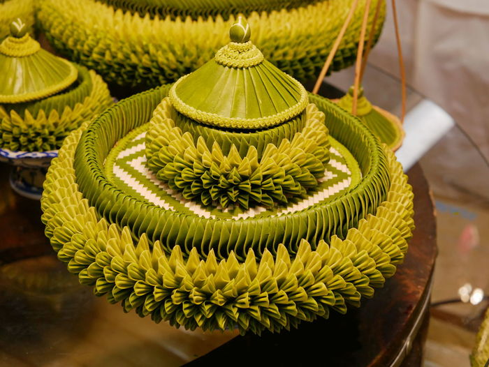 Thai traditional style handmade natural banana leaf tray and bowl with cap for food and dessert Tray Banana Leaf Leafs Leaves Green Natural Material Bowl Cup Cap Lid Handmade Traditional Thai Style Container Art For Food For Dessert Close-up No People Beautiful Elegant Skill